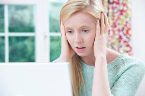 Teenage Victim Of Online Bullying With Laptop